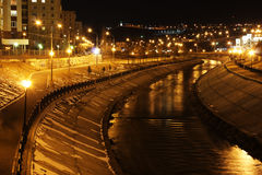 River embankment. Illuminated by lights at night Royalty Free Stock Image