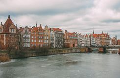 River embankment with nice old houses in Gdansk stock photography