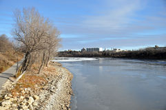 River embankment. The photo was taken on the waterfront of the Red River in Winnipeg, Manitoba. Canada. November 2013 Stock Photos