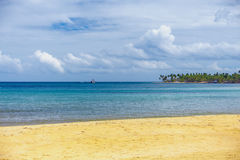 The river empties into the ocean. On sandy beach royalty free stock photo