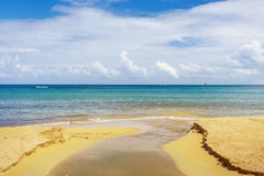 The river empties into the ocean. On sandy beach royalty free stock images