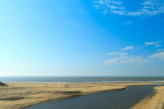River estuary entering the sea on the Dutch coast Stock Images