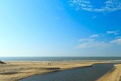 River estuary entering the sea on the Dutch coast Stock Images