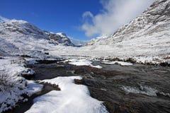 The River Etive. Running through a snowy Glencoe glen Stock Photo