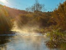 River with evaporating on a very cold morning stock photo