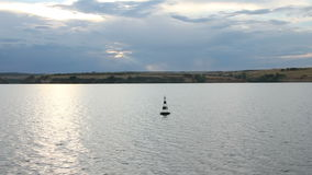 River evening landscape. Over the buoy. Volga cruise, Russia. Summer, sky, clouds. Filming from a moving boat.  stock video footage