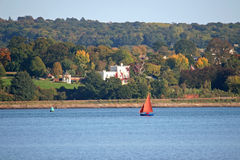 River Exe. Dinghy sailing on River Exe Stock Images