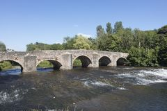 River Exe flowing under the medieval bridge at Bickley Devon England. The River Exe flowing under the medieval stone bridge at Bickley in Devon England a natural Stock Photography