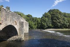 River Exe and the bridge at Bickley. The River Exe flows under the old medieval stone bridge at Bickley in Devon England Royalty Free Stock Photography