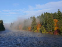 The River in Fall. A fall scene on the river as the water steams in the frigid air stock photos