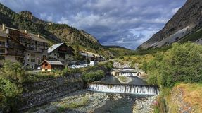 River fall at Cervieres village, Alps mountains, Royalty Free Stock Images