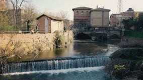 River falls canal lock water flow in Bologna city landmark called Sostegno del Battiferro Navile canal