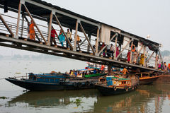 River ferry passengers go ashore at the dock Stock Image