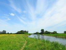 River, field and beautiful cloudy sky, Lithuania Stock Photography