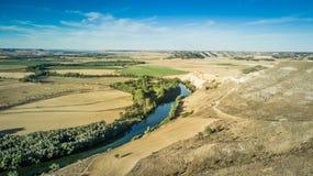 River in field of castilla,Valladolid, Spain. River in field of castilla under  a blue sky, Valladolid, Spain Stock Photography