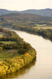 River through Fields. A river runs through fields and hills, barns and farm land royalty free stock image