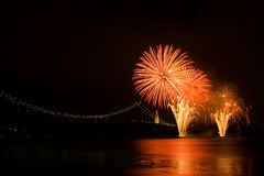 River Fireworks. Fireworks over Tagus river near April 25th bridge. Lisboa, Portugal Royalty Free Stock Image