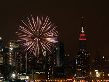 River Fireworks NYC. Fireworks explode over the Hudson River Royalty Free Stock Images