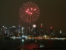 River Fireworks NYC 3. Fireworks explode over the Hudson River Royalty Free Stock Photo