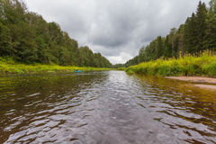The river and  fisherman on the inflatable boat Stock Photo
