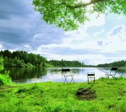 River Fishing. Place under blue sky nobody on chairs Stock Photos