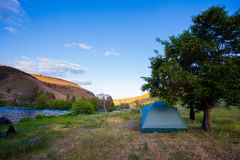 River Float Camping Lower Deschutes River Oregon. Lower Deschutes River in Oregon hosts campsites along the riverbanks for campers float camping next to the Stock Images