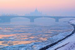 River, floes, Margaret bridge, Parliament outline in winter, Budapest stock photos