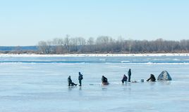 River flood fishermen. Torn river ice fishermen. River with the Stock Images
