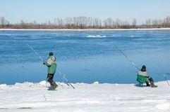 River flood fishermen. Torn river ice fishermen. River with the Stock Image