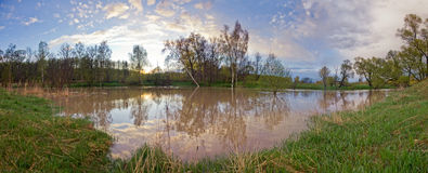 River in flood at sunset Royalty Free Stock Image