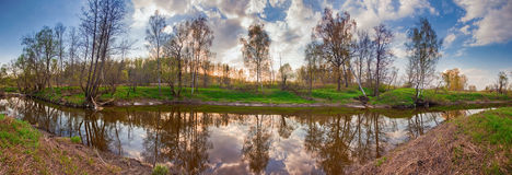 River in flood at sunset. Spring panorama with the river in flood at sunset stock image