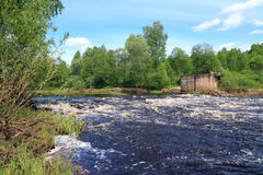 River flow. On old destroyed dam stock photo