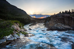 River flow. At sunset near Swift Current Lake, Glacier National Park Royalty Free Stock Photos