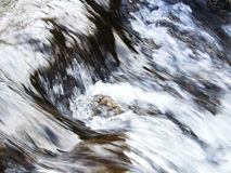 River flow. Close-up of clear river water flowing over rocks in the Lake District, UK Royalty Free Stock Images
