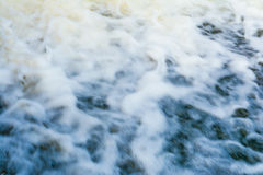 River flow, fast water flow forms a lot of foam and bubbles, abstract background Royalty Free Stock Photo