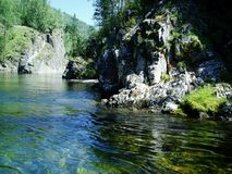 River flow, rests on a rocky ledge on ` hem, in the Eastern Sayan. A river that carries water in a mountain valley of the Eastern Sayan mountains Stock Photo