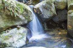 River flowing through boulders Stock Photo