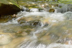 River flowing on cataract and water splashing Stock Photo
