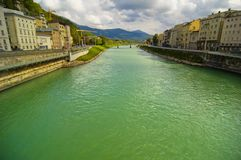 River Flowing Through A City Stock Photo