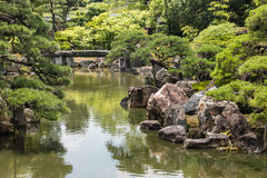 River flowing through Japanese garden Royalty Free Stock Images