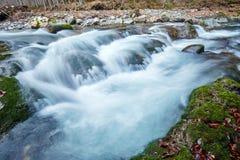 River flowing through mountain Stock Image