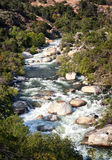 A river flowing through mountains. Stock Image