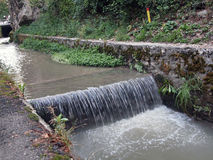 River flowing  near Graft Bastion, Romania, Transylvania, Brasov Stock Photography