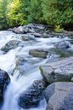 River Flowing Over Rocks  Stock Photography