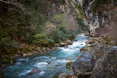 River flowing over rocks Royalty Free Stock Images