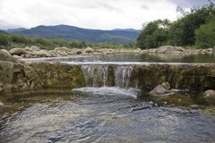 river flowing over rocks Stock Images