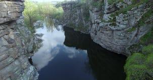 River flowing between rocks aerial view stock video