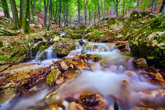 River flowing through rocks Royalty Free Stock Photography