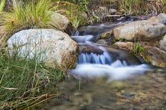 River flowing through rocky terrain Royalty Free Stock Photos