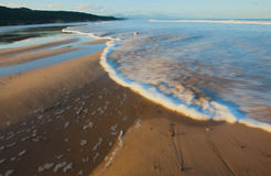 River flowing into sea. Scenic view of mouth of river flowing into sea on sandy beach, Hartenbos, Garden Route, South Africa Royalty Free Stock Photo